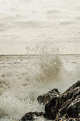 Waves crashing on rocky coast - p1628m2209898 by Lorraine Fitch