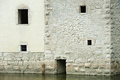 !7th Century building surrounded by water - p623m844872f by Odilon Dimier