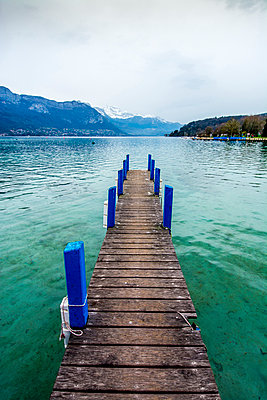 Jetty overlooking Annecy lake, Alpes, France - p813m1122828 by B.Jaubert