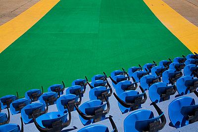 Empty sports stadium seats - p924m805895f by Perry Mastrovito
