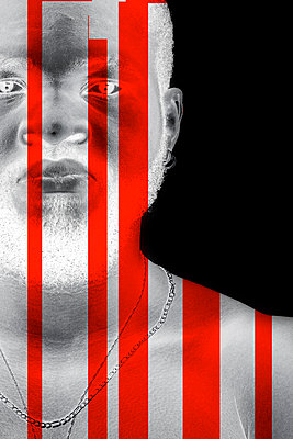Man in front of red stripes - p975m2279026 by Hayden Verry