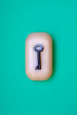 Old key in a bar of soap - p1228m2192781 by Benjamin Harte