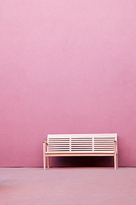 Bench in Front of Pink Wall - p1100m2090924 by Mint Images