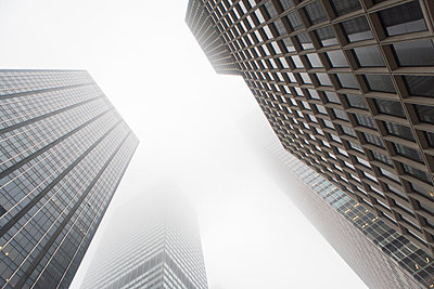 Angled view of skyscrapers in mist - p924m884352f by Ditto