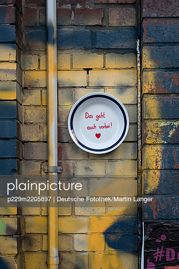Painted plate on a wall - p229m2205897 by Martin Langer