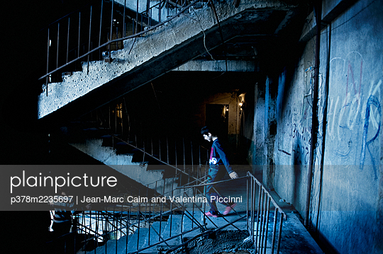 Boy in dilapidated building - p378m2235697 by Jean-Marc Caim and Valentina Piccinni