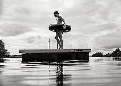 Boy on Dock  - p1503m2015879 by Deb Schwedhelm
