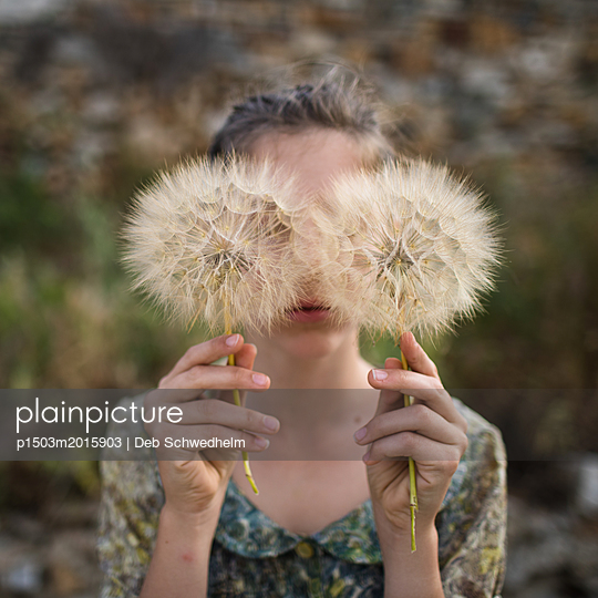 Girl Holding Giant Dandelion - p1503m2015903 by Deb Schwedhelm