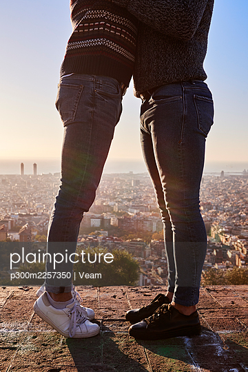 Legs of gay men standing on observation point against clear sky in city, Bunkers del Carmel, Barcelona, Spain - p300m2257350 by Veam