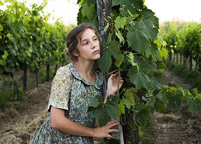 Girl in Vineyard - p1503m2015855 by Deb Schwedhelm