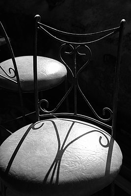 Old metal chairs in harsh light - p1580m2210134 by Andrea Christofi