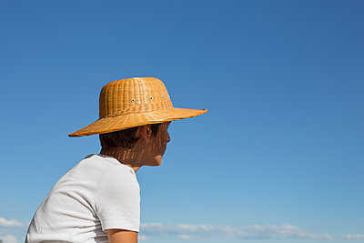 Teenager with a straw hat - p445m1177047 by Marie Docher