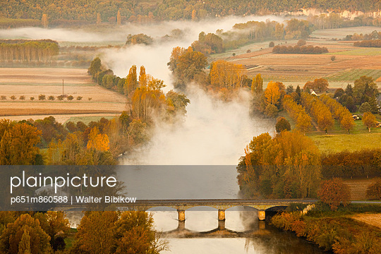 France, Aquitaine Region, Dordogne Department, Domme of the Dordogne River Valley in fog from the Belvedere de la Barre - p651m860588 by Walter Bibikow