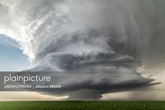 Landscape with massive supercell in the Eastern Texas panhandle, USA. Massive baseball-sized hail fell with this storm - p924m2098364 by Jessica Moore