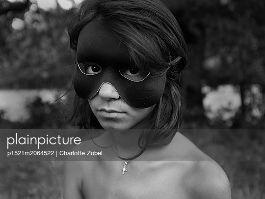 Girl with face mask - p1521m2064522 by Charlotte Zobel