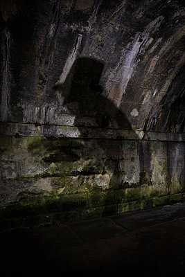 Creepy silhouette in a tunnel - p1652m2230707 by Callum Ollason