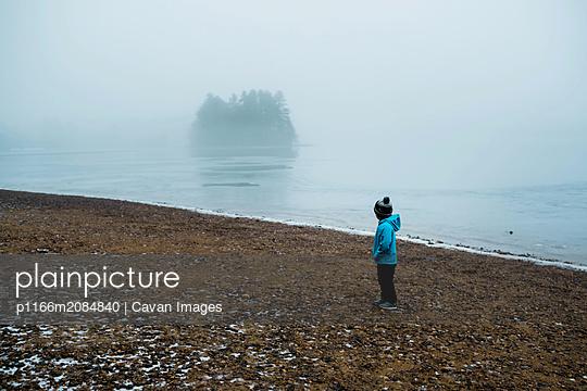 boy on a frozen beach. - p1166m2084840 by Cavan Images