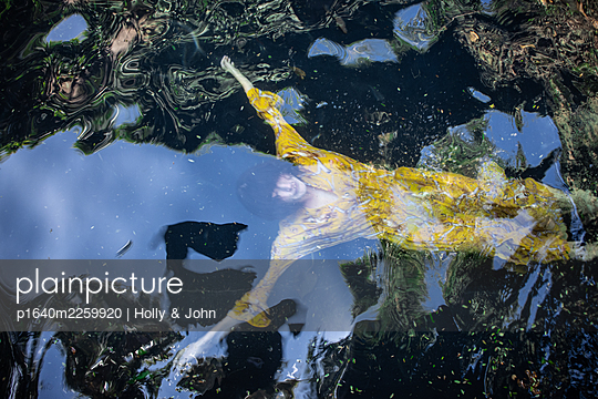 Woman in yellow dress in the lake - p1640m2259920 by Holly & John