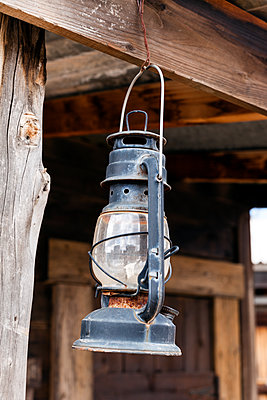 Low angle view of old lantern hanging from a wooden beam - p1094m1209091 by Patrick Strattner