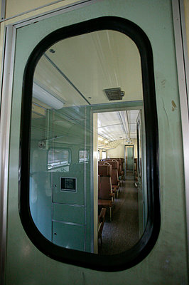 Train carriage seen through window - p3882109 by L.B.Jeffries