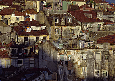Worn-down houses. - p528m1075615f by Hans Nohlberg