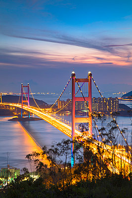 Tsing Ma Bridge at sunset, Tsing Yi, Hong Kong, China - p651m2033229 by Ian Trower
