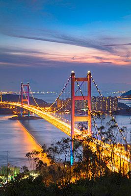 Tsing Ma Bridge at sunset, Tsing Yi, Hong Kong, China - p651m2033229 by Ian Trower
