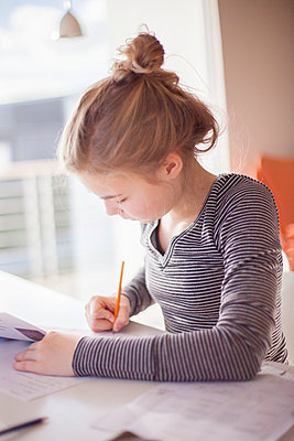 Girl doing homework - p312m1470562 by Christina Strehlow
