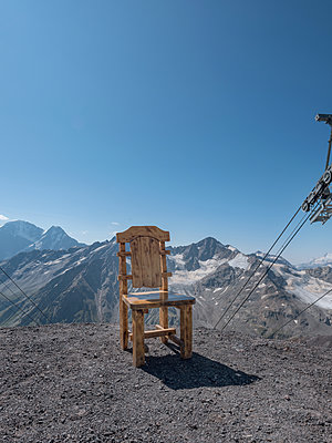 Wooden chair on a mountain next to a cable car - p390m2109307 by Frank Herfort