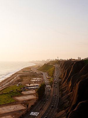 Coast road at sunset - p1177m2111156 by Philip Frowein