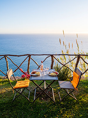 Portugal, Madeira, Table for two - p1600m2175647 by Ole Spata