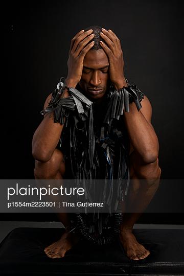 African man wearing designer fashion - p1554m2223501 by Tina Gutierrez