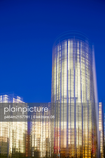 Illuminated office buildings - p464m2157781 by Elektrons 08