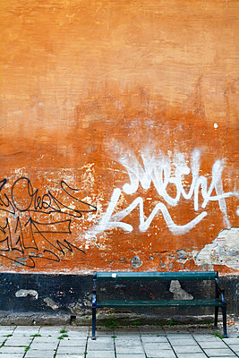 Graffiti on a wall and a bench Sweden - p5280063f by Pernilla Hed