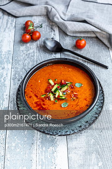 Gazpacho - cold tomato soup with cucumber topping - p300m2167471 by Sandra Roesch