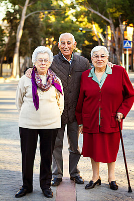 Portrait of senior adults standing on road - p1166m979800f by Cavan Images