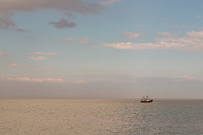 Fishing trawler out at sea - p1228m1466081 by Benjamin Harte