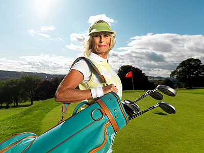 Mature lady playing golf - p4296141 by Colin Hawkins