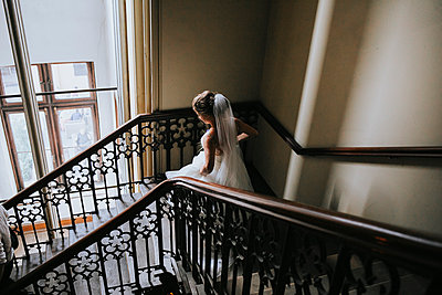 Bride in the staircase - p680m2176340 by Stella Mai