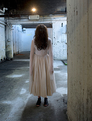 Ghostly figure stands still in doorway - p1072m905531 by Mia Mala McDonald