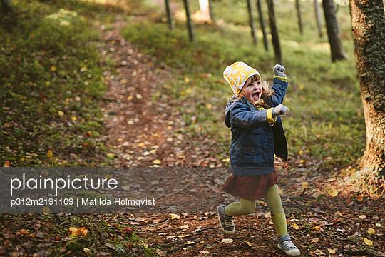 Happy girl in forest - p312m2191109 by Matilda Holmqvist