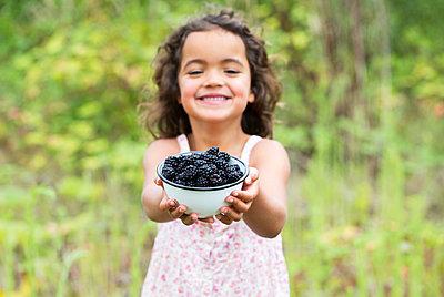 Girl with Blackberries - p1231m1466435 by Iris Loonen