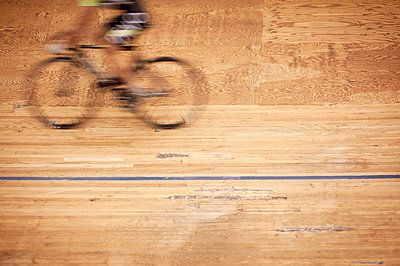 Blurred motion of cyclist racing on track - p301m976106f by Jay Delaney