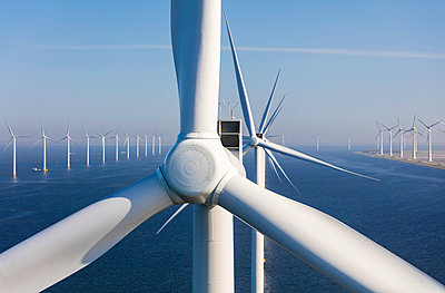Aerial view of wind turbines at sea, North Holland, Netherlands - p651m2006479 by Peter Adams