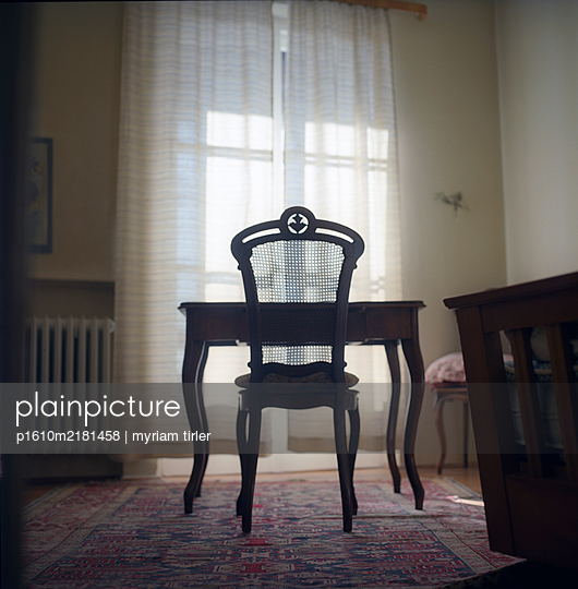 Wooden chair in backlight - p1610m2181458 by myriam tirler