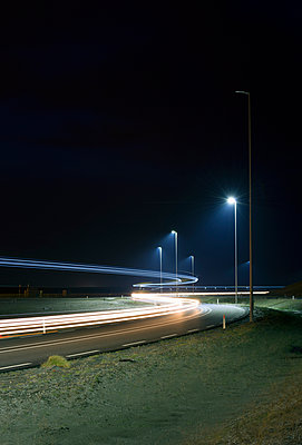 Night time shot of new road build on land reclaimed from sea - p429m895968 by Mischa Keijser