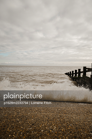 Winter Sunday on the beach - p1628m2233794 by Lorraine Fitch