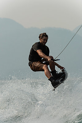Man wakeboarding in the river - p1315m2056243 by Wavebreak