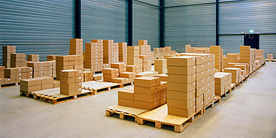 Cardboard boxes in warehouse - p42918745 by Mischa Keijser