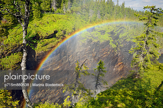 Rainbow above a water fall - p715m880638 by Marina Biederbick